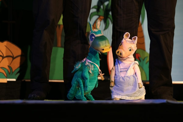 Why is the Augsburger Puppenkiste the famed and successful marionette theatre that it is?